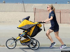 photo: anna paquin runs with baby stroller
